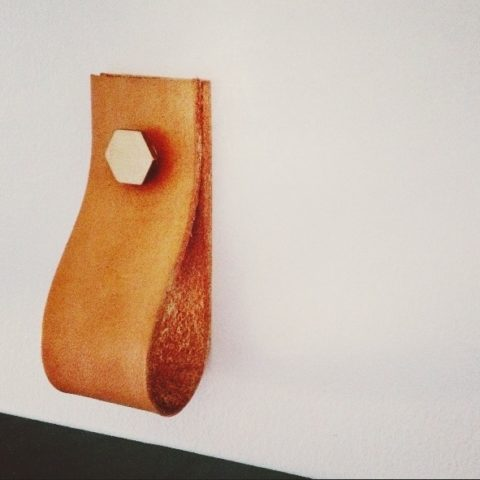 Leather and brass pulls by CAMP [http://www.campprovisions.com/product/leather-brass-pulls]