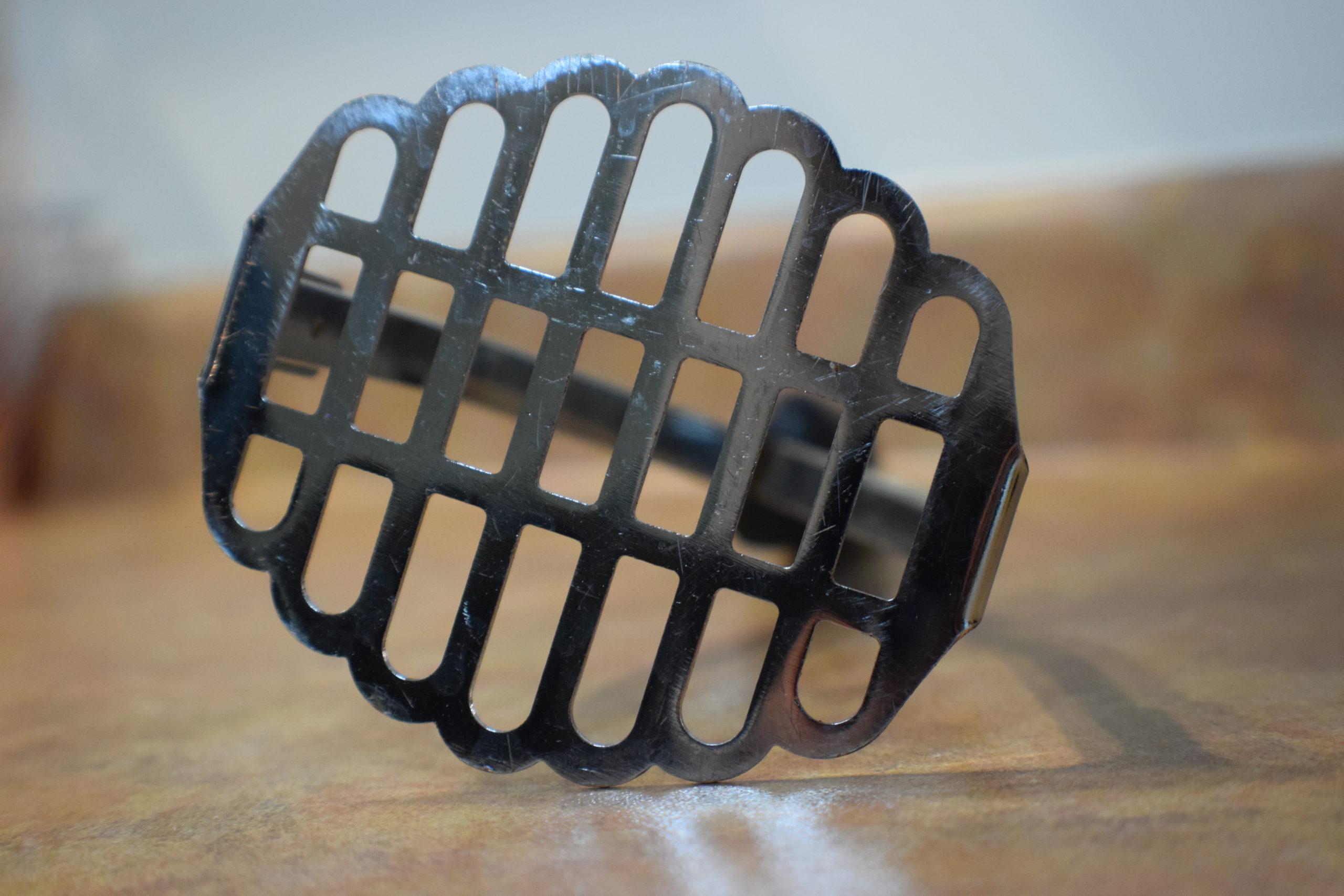 metal mashing utensil on a counter