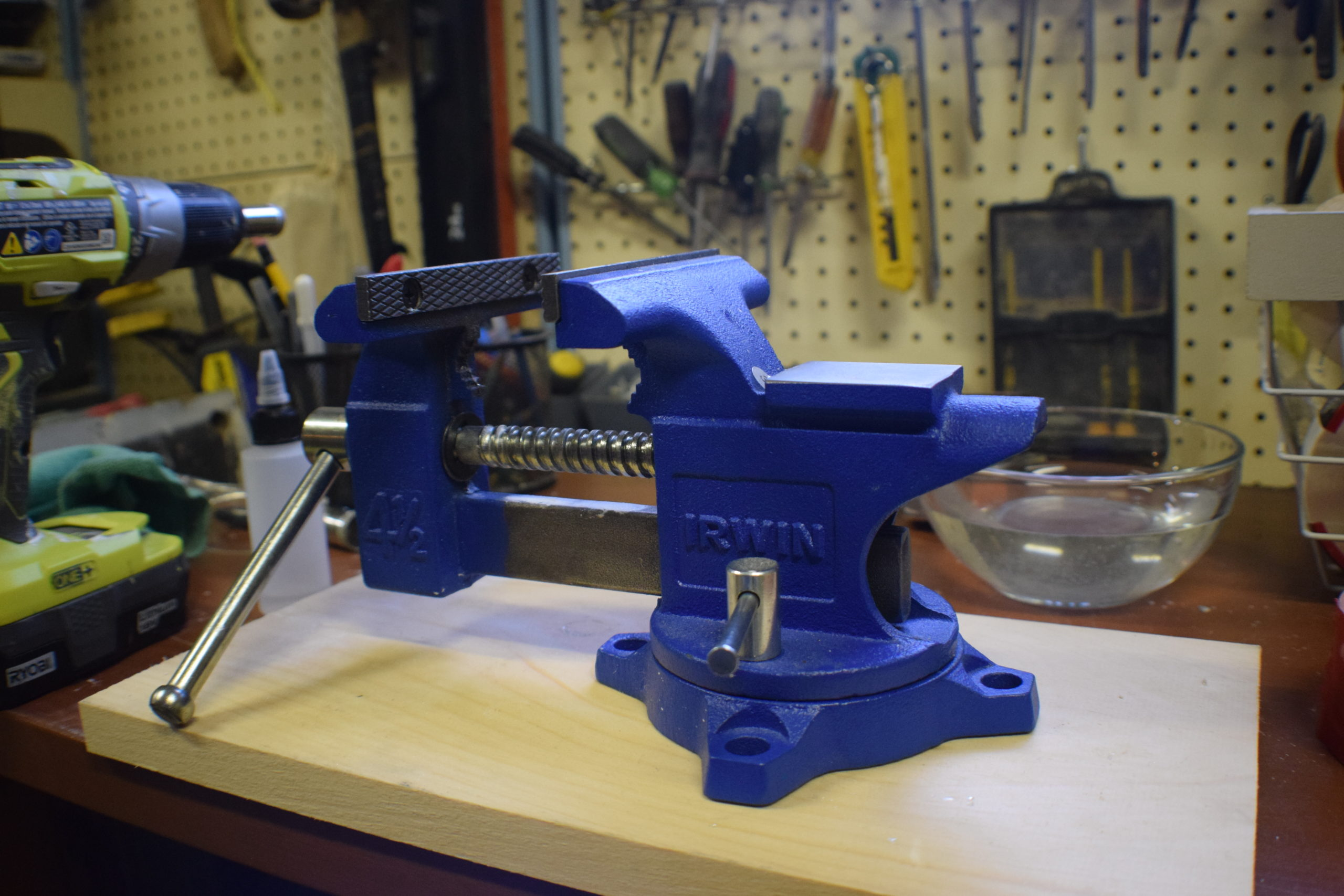 blue vice by irwin with silver nobs on a work bench