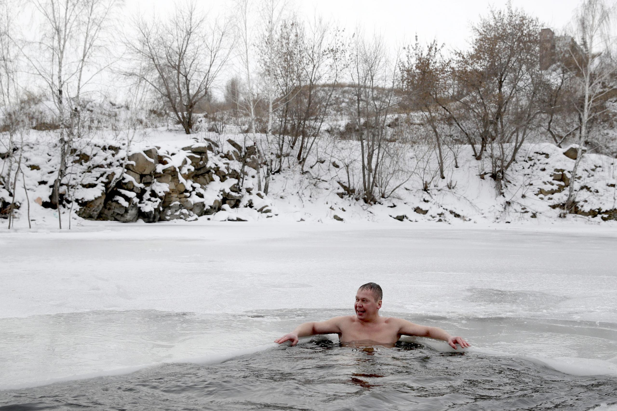 man sitting in hot water spring