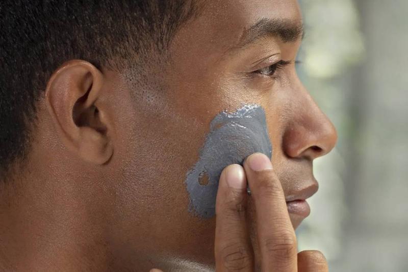 Man rubbing product into skin