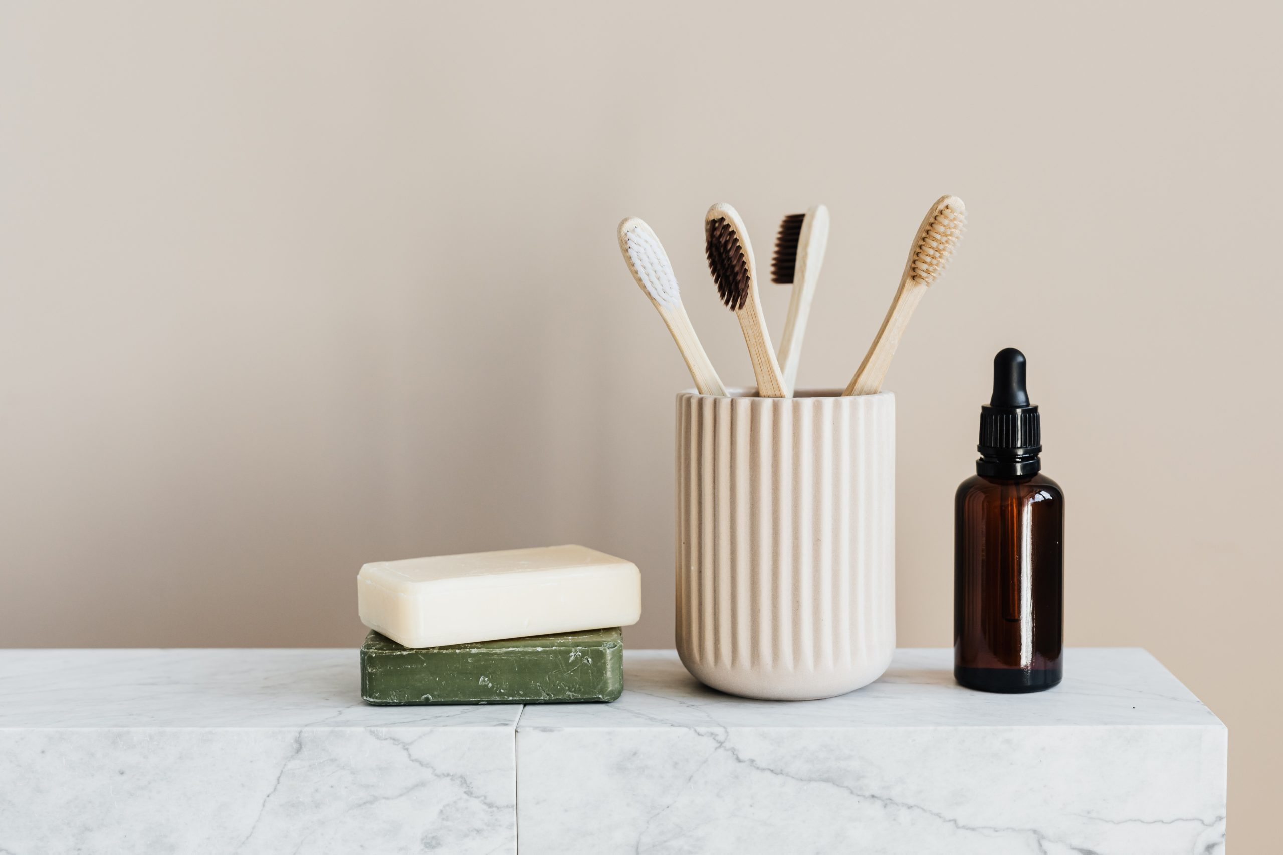toothbrushes air drying in masculine bathroom with soap and oil