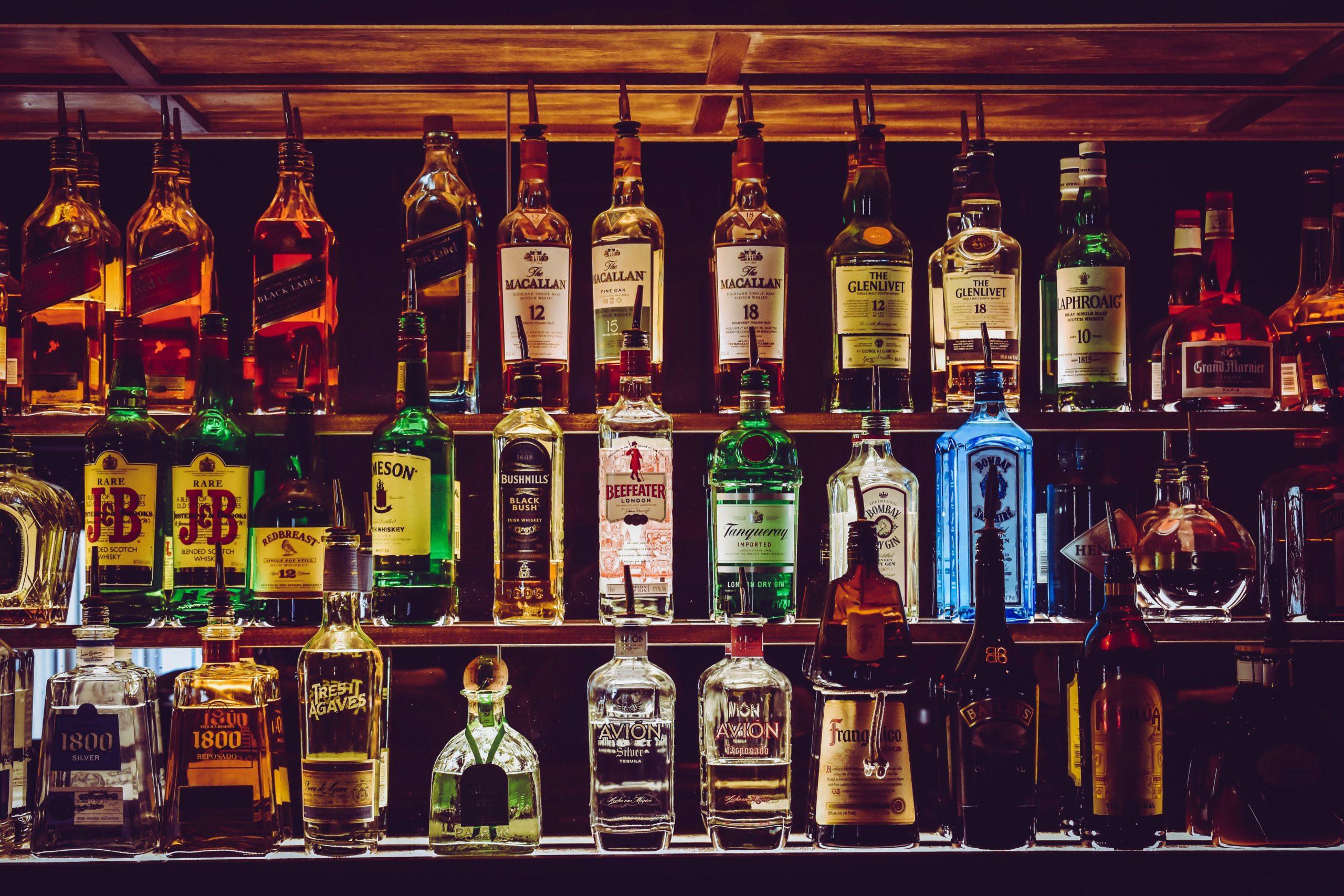 shelves with liquor in a dark bar