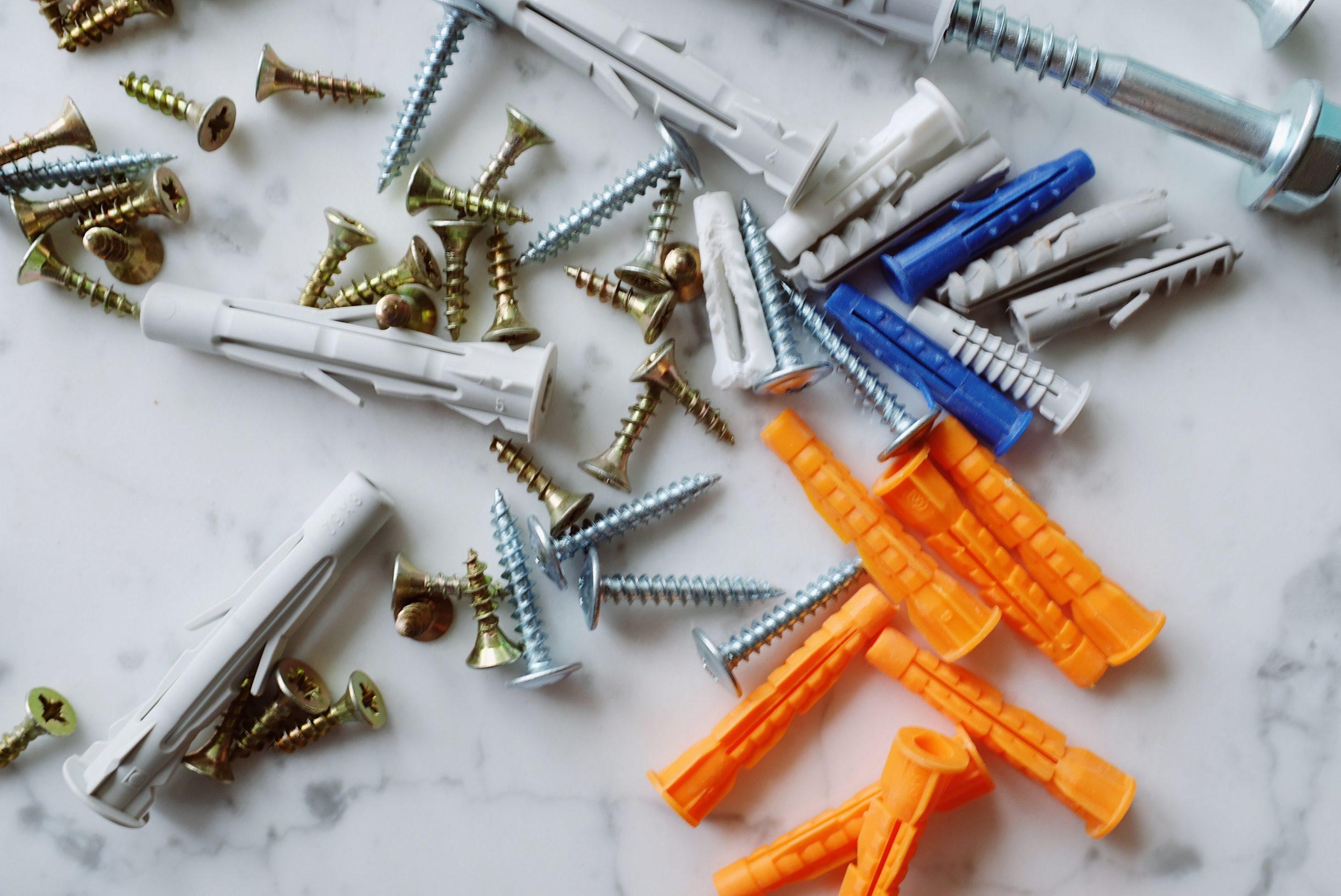 plastic multicolored dowels with metal screws