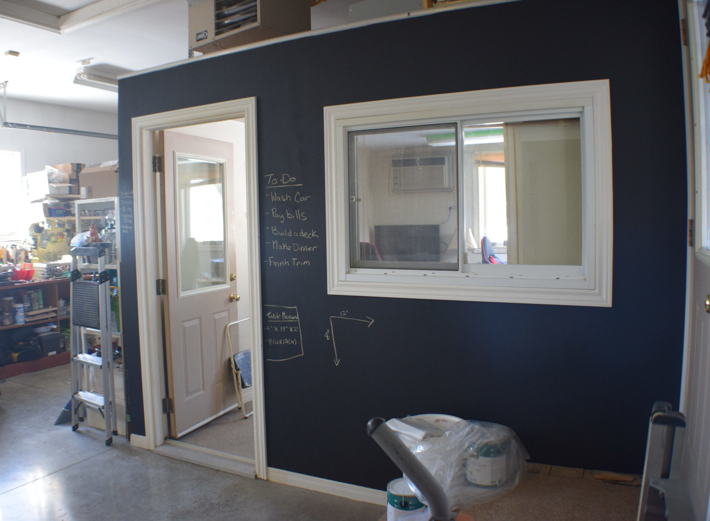 black chalkboard wall on an office wall in a garage
