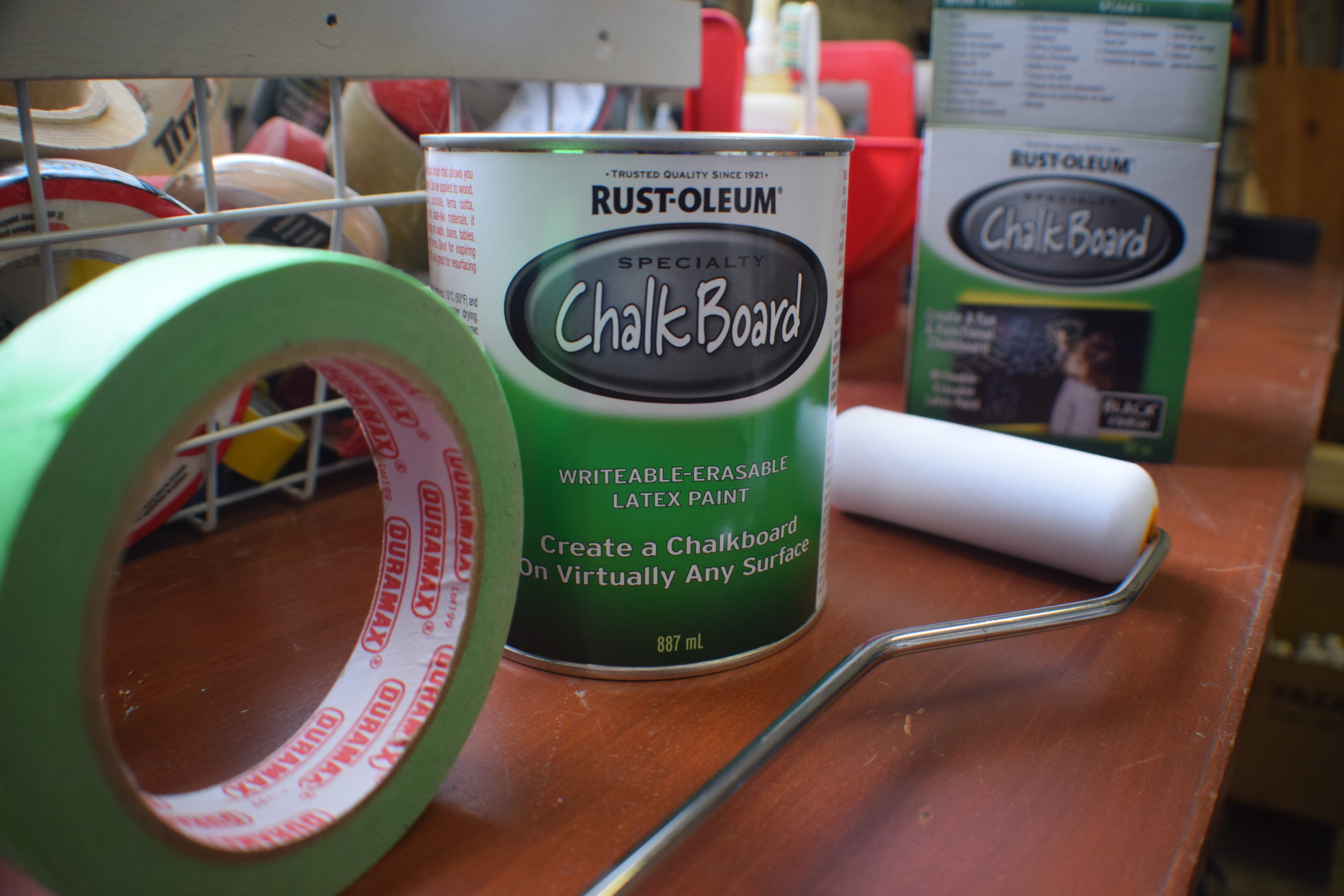 Supplies for painting a chalkboard wall on a tool bench