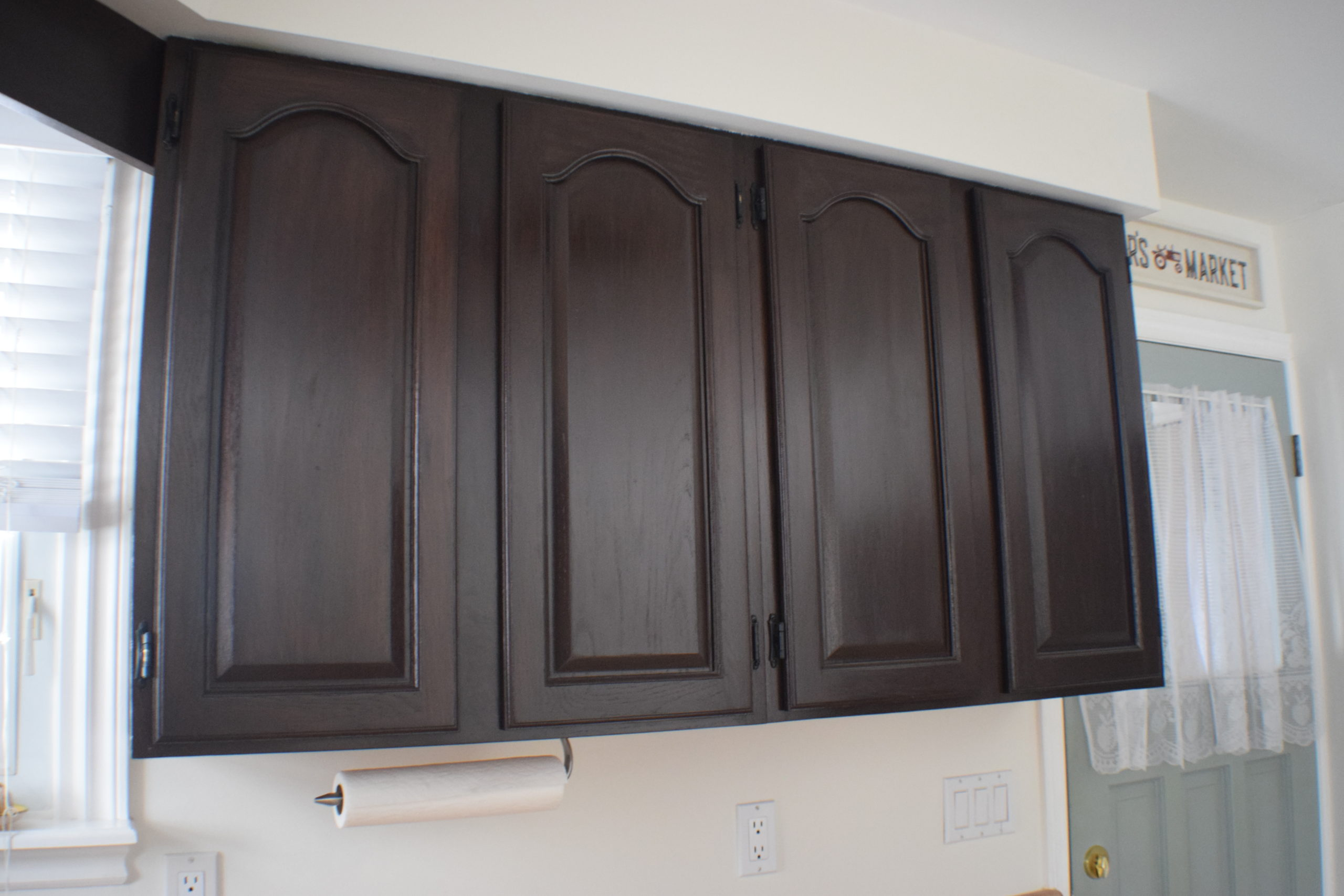 for of upper kitchen cabinets in dark stain without handles