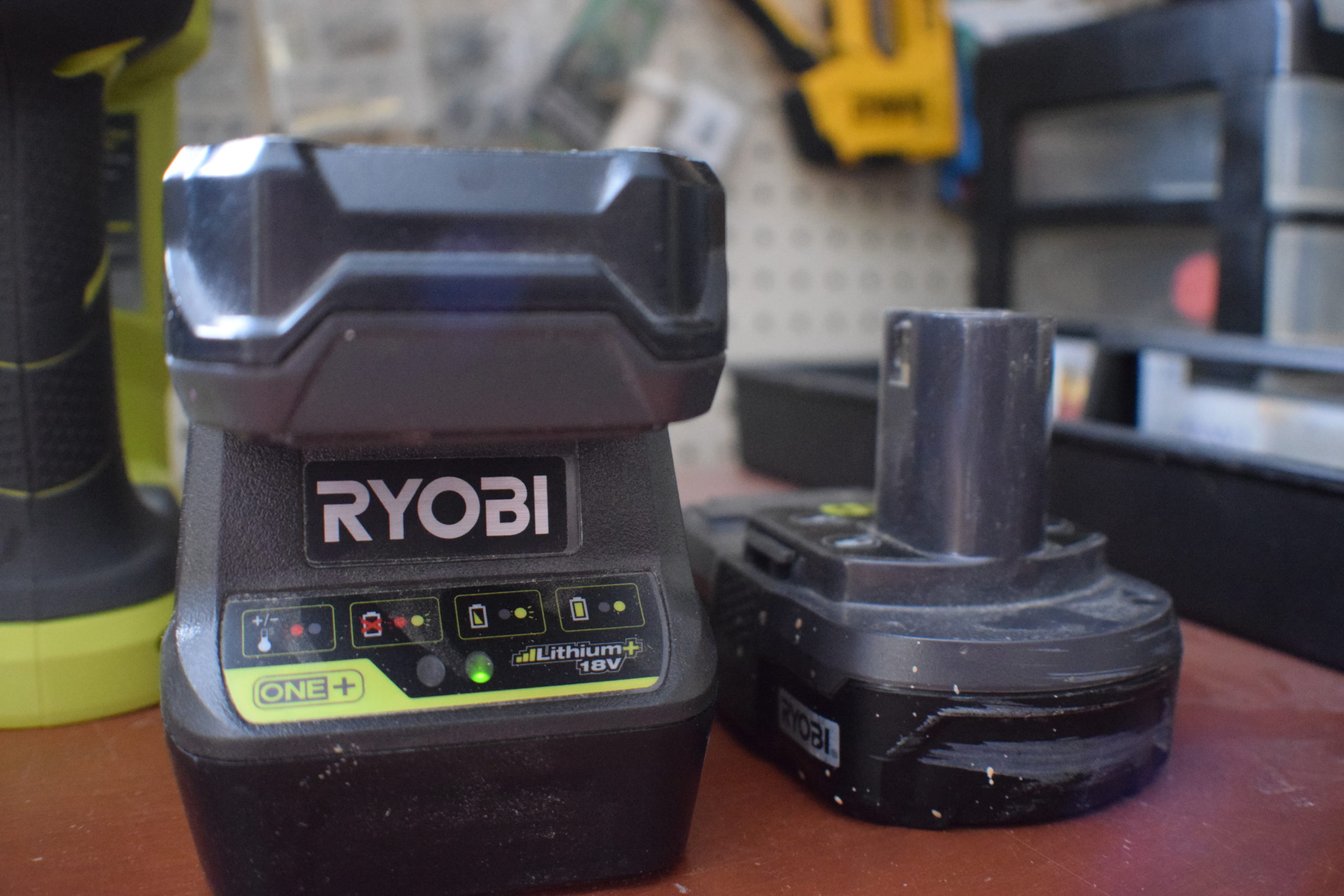 ryobi battery charger and 2 batteries in a workshop