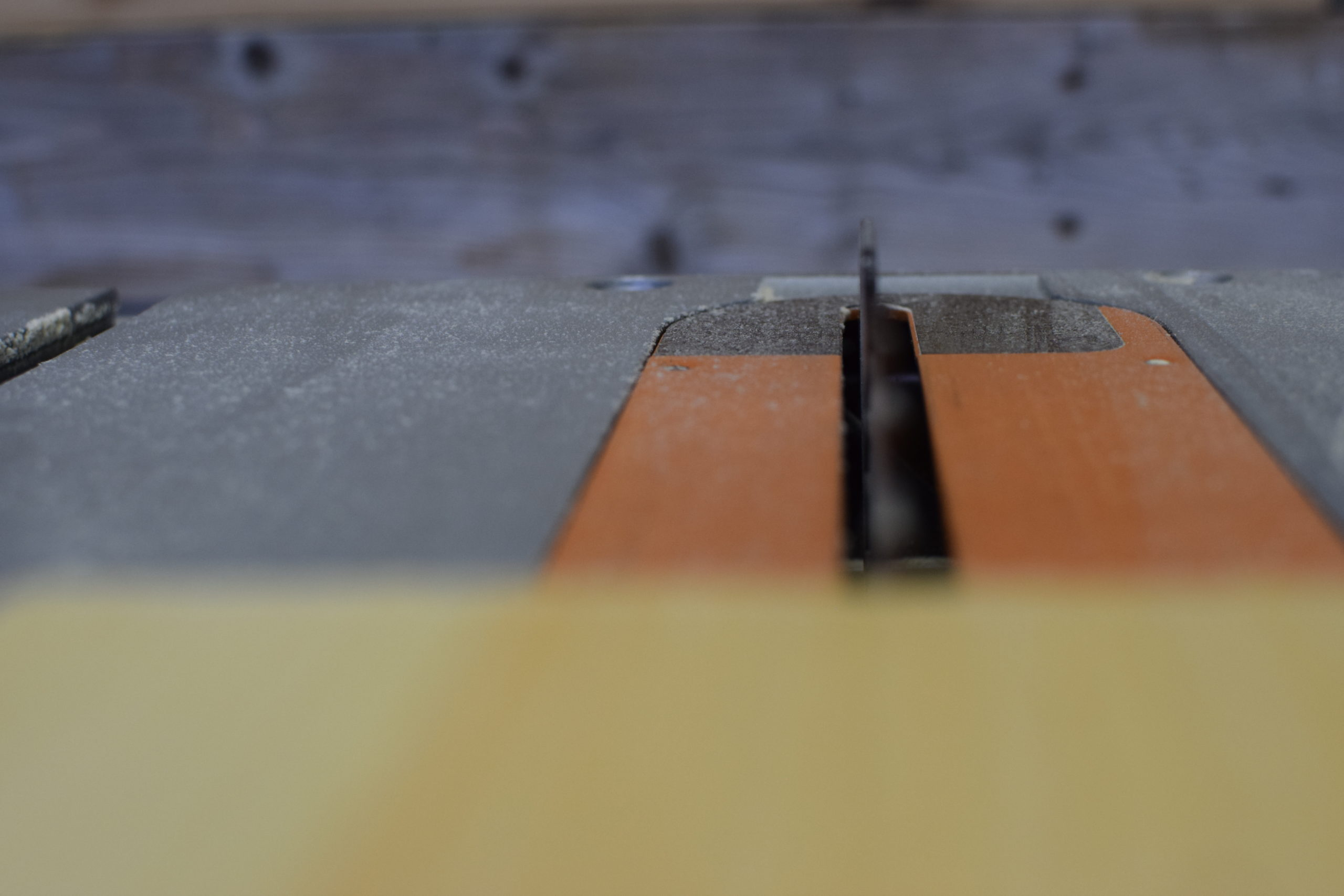 table saw blade in action ready to cut wood