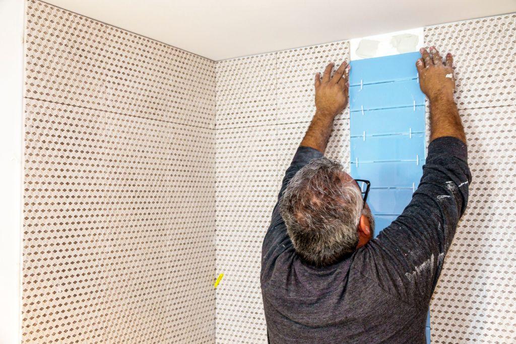 contractor installing bathroom tille