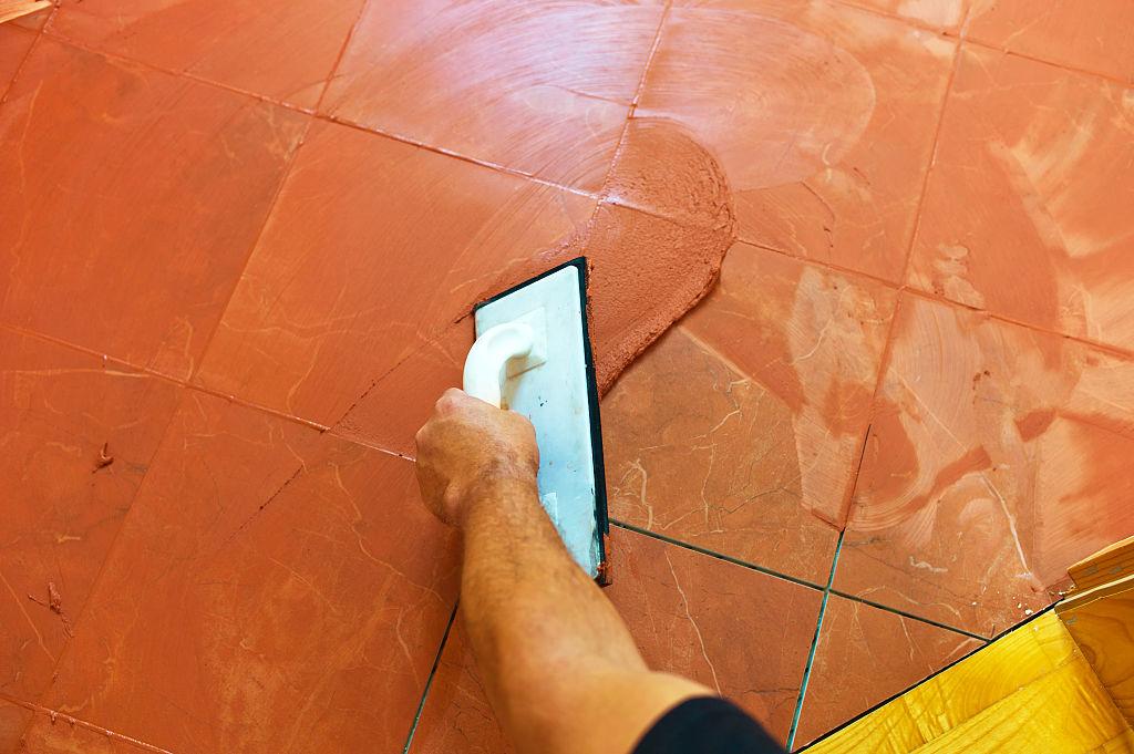 orange grout used to match orange tile