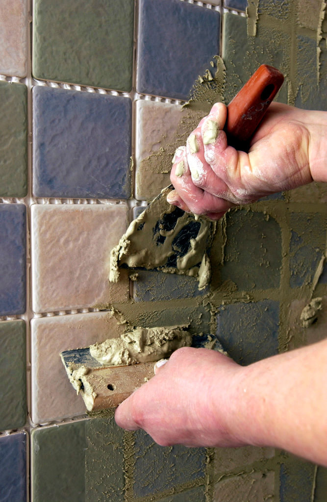 Apply grout upwards on vertical tiles.