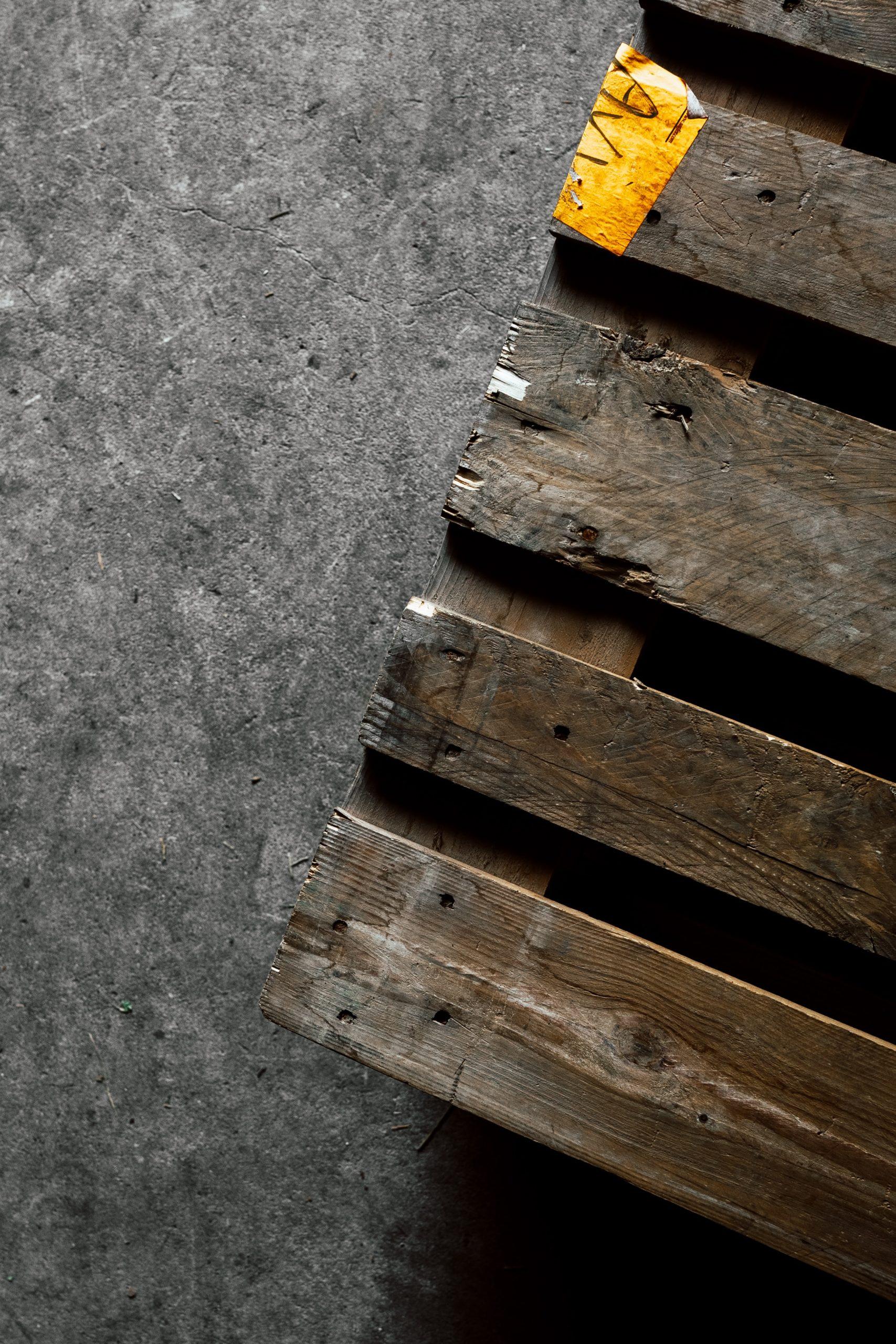 old wooden pallet on cement floor