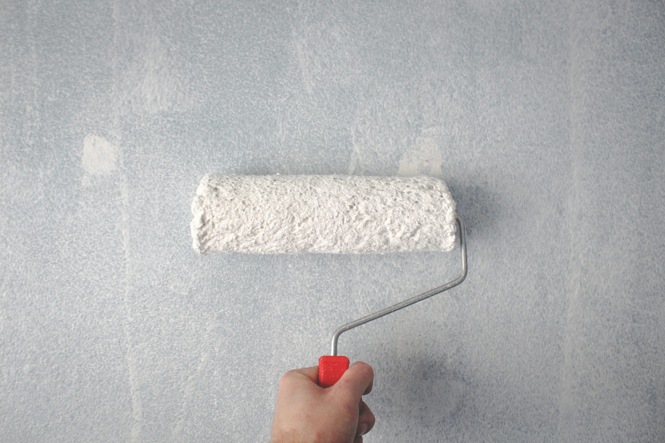paint roller covering hole in wall