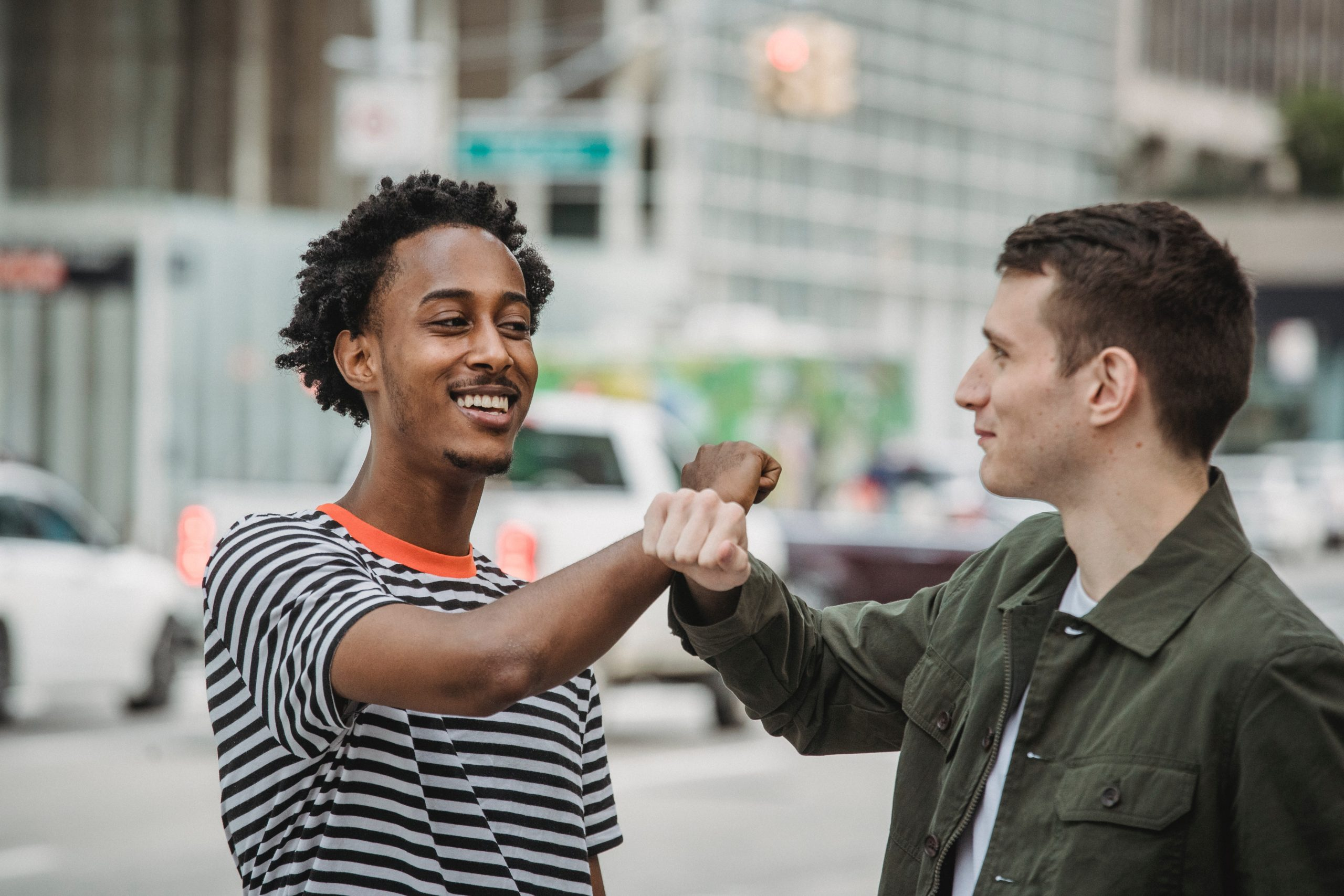two men fist bumping