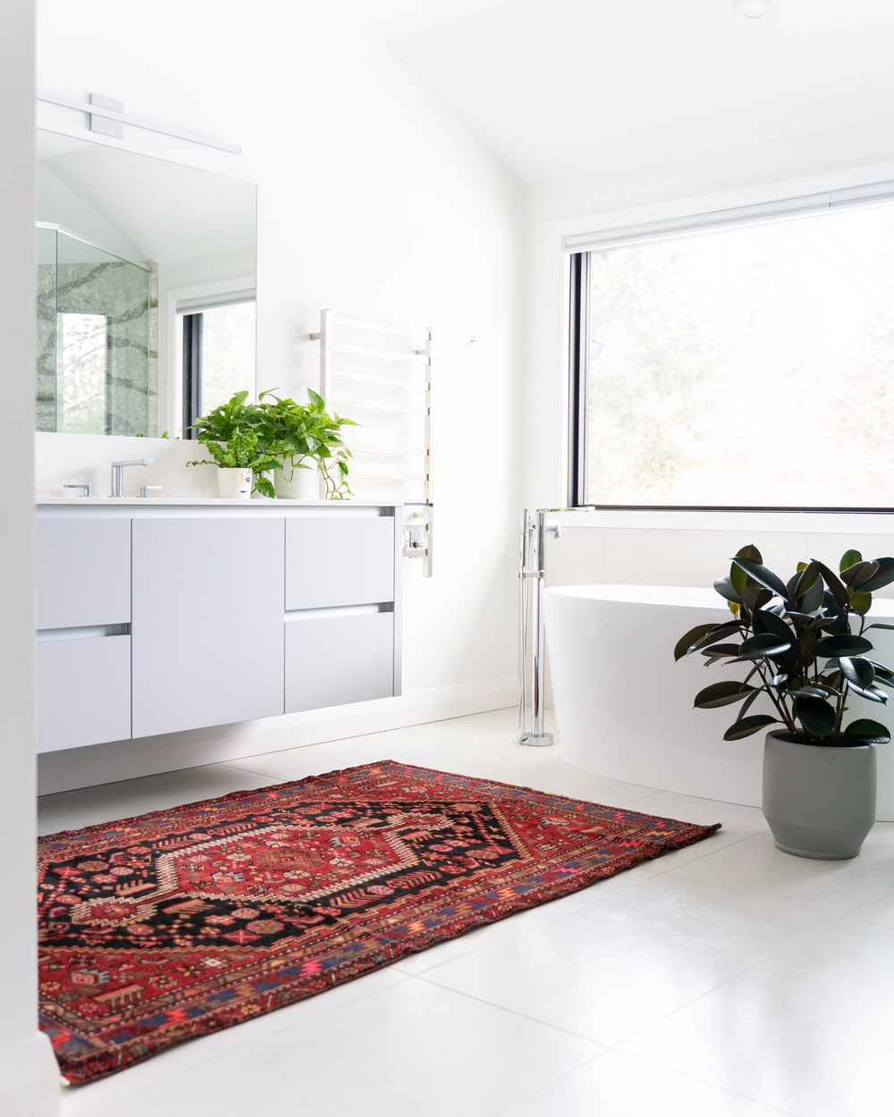 all white bathroom with potted plant