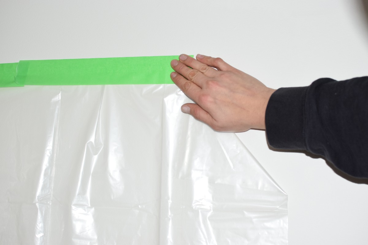 using painters tape to secure a drop cloth
