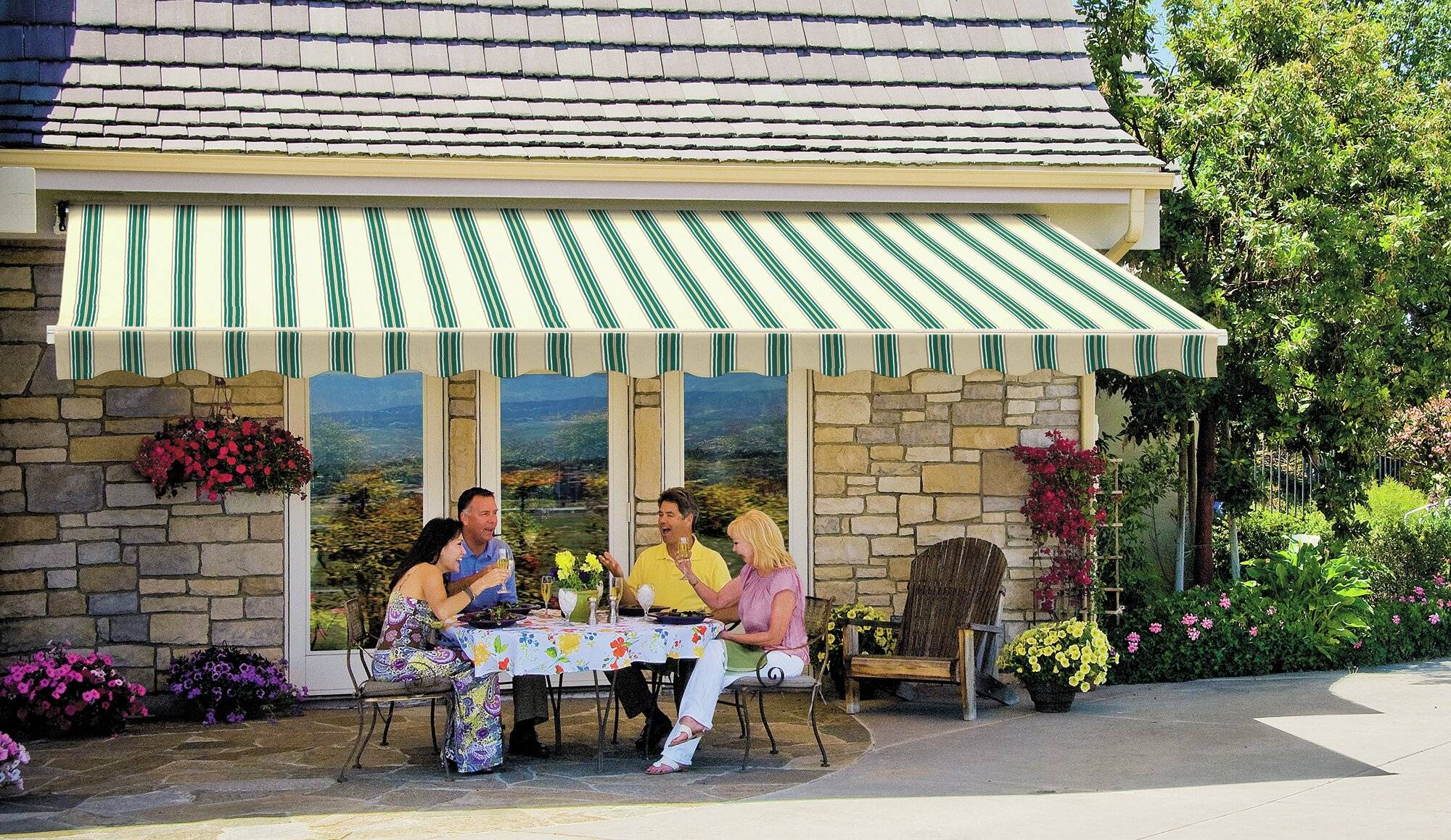 Four people enjoying a meal under a shade