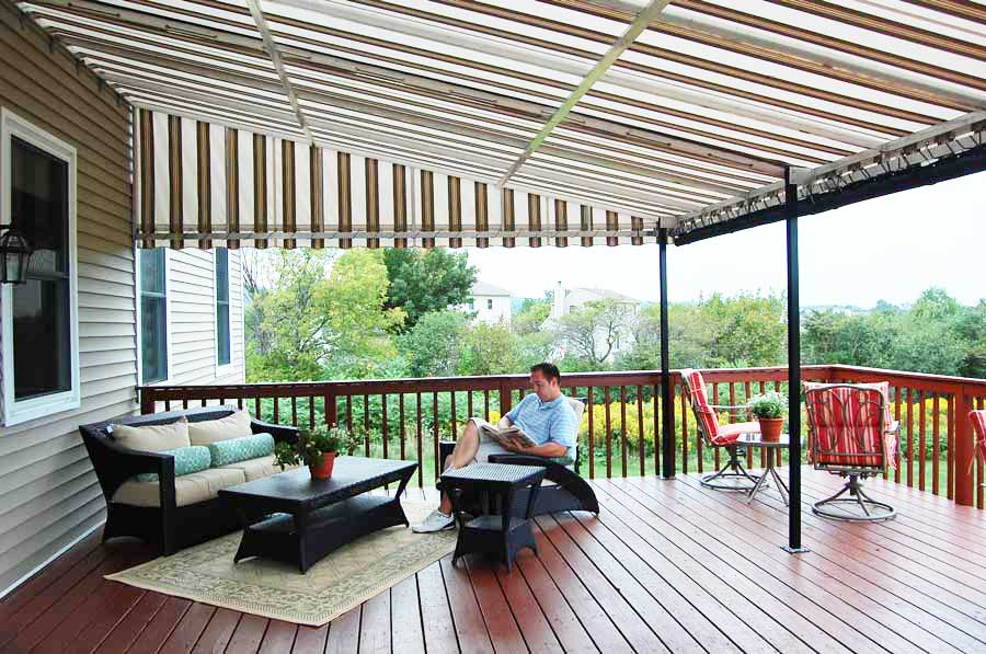 Man sitting and reading a book in the patio