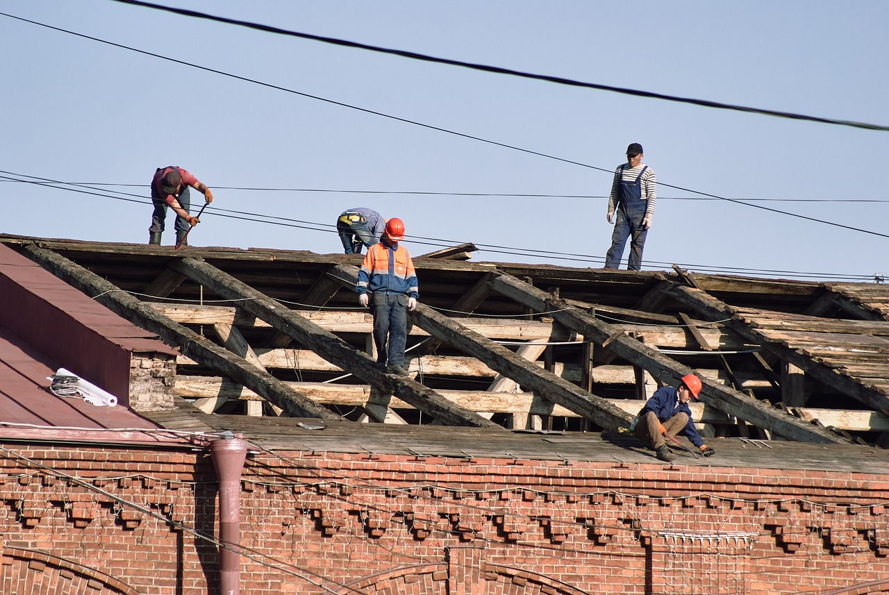 Men replace roof