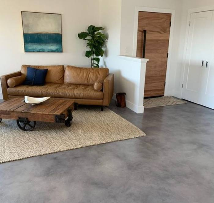 light stained concrete floor in living room