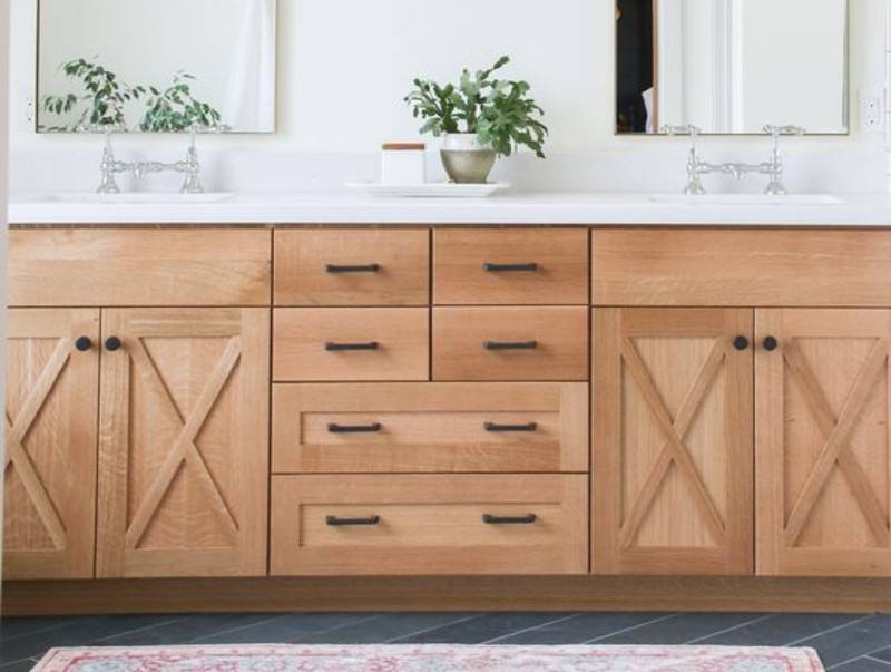 wooden bathroom cabinets with black hardware
