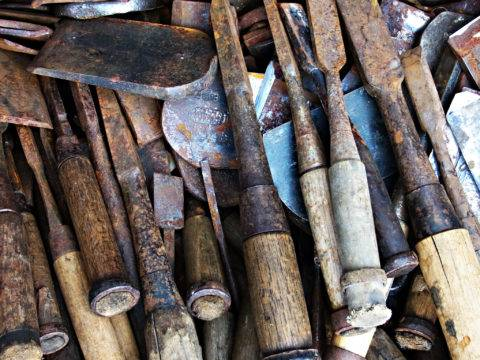 pile of rusted tools