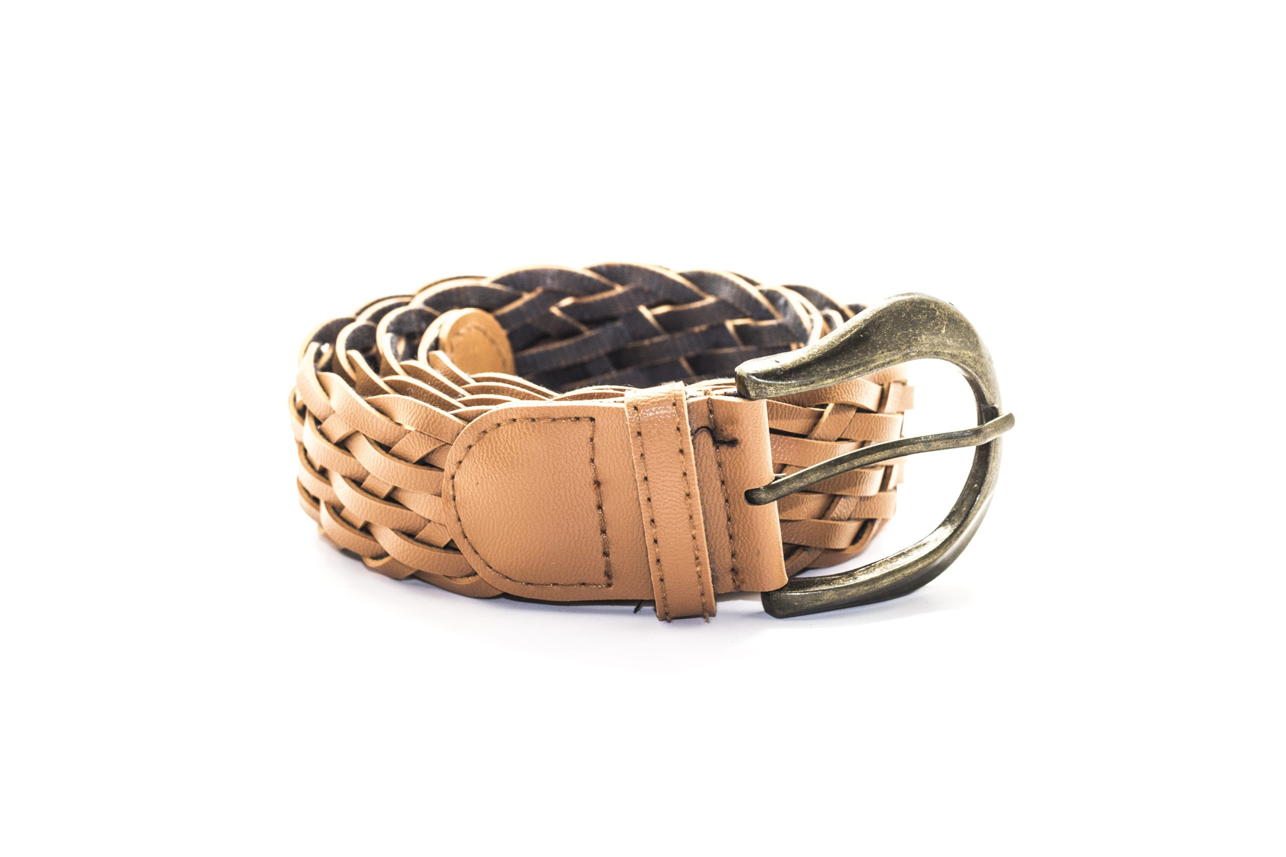 Brown braided leather belt in white background