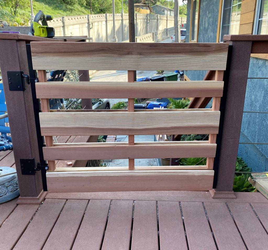 Final product from our guide on how to build a deck gate