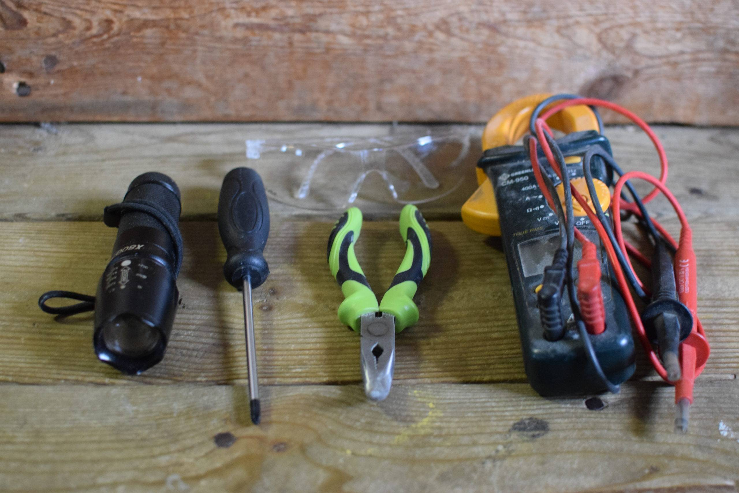 Flashlight screwdriver pliers and voltage tester