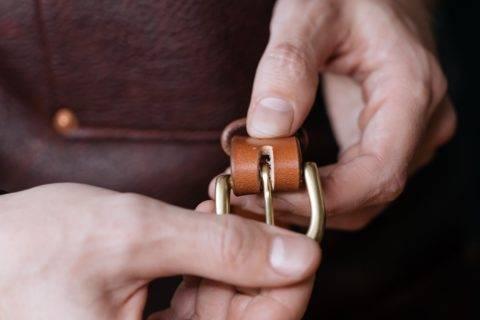 Hands holding belt buckle