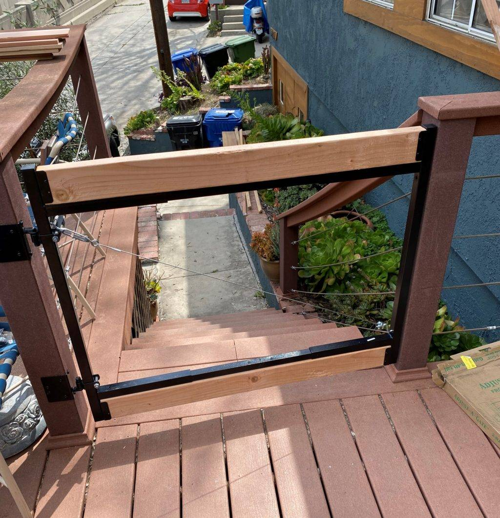 A metal fence frame with two pieces of wood attached