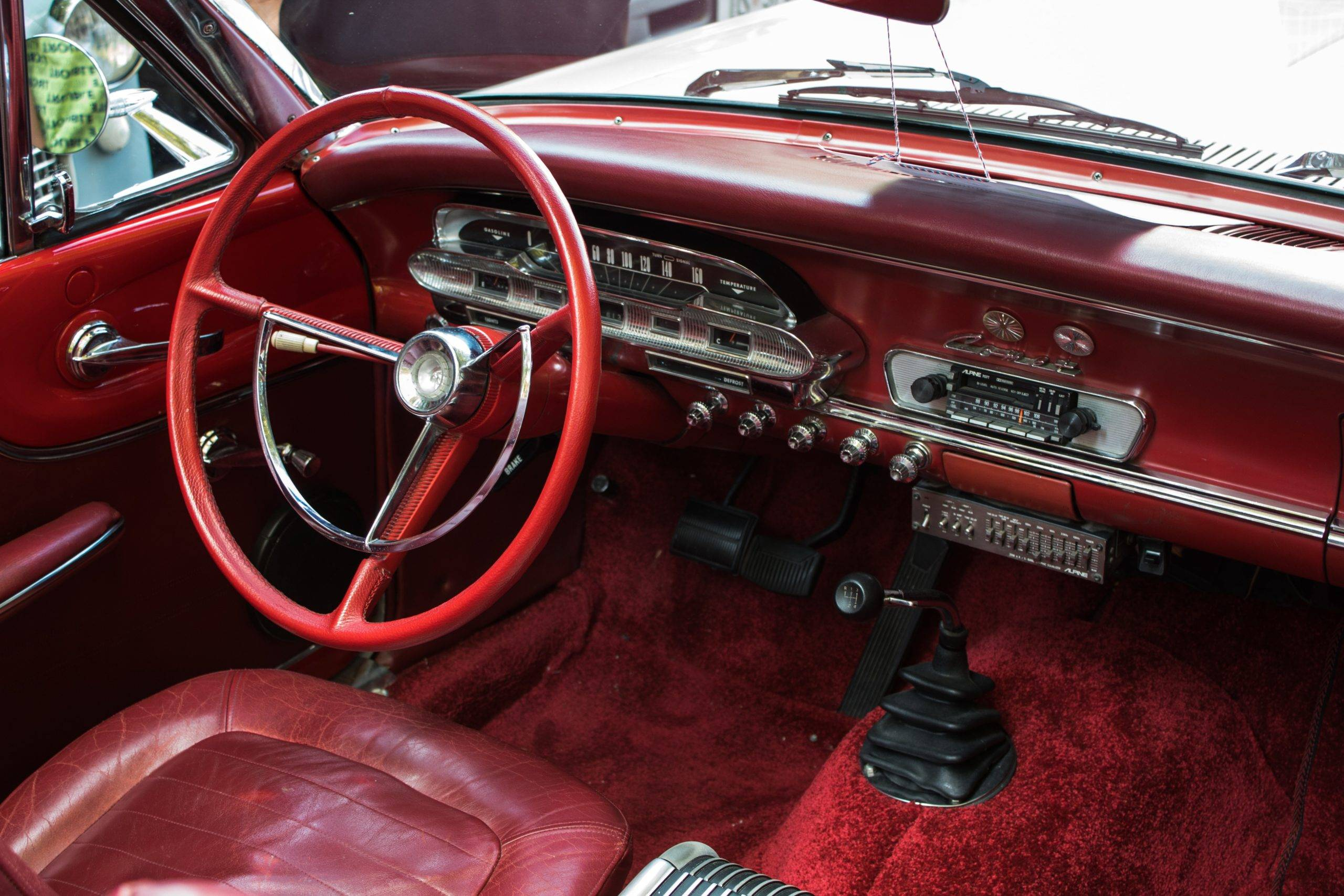 Red car interior with large red steering wheel