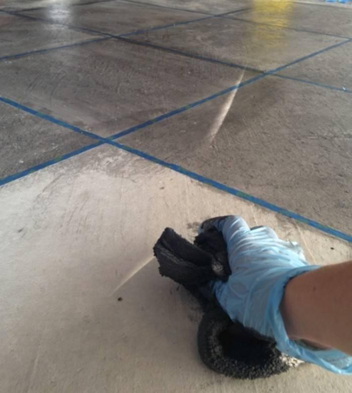 staining concrete floor with rag