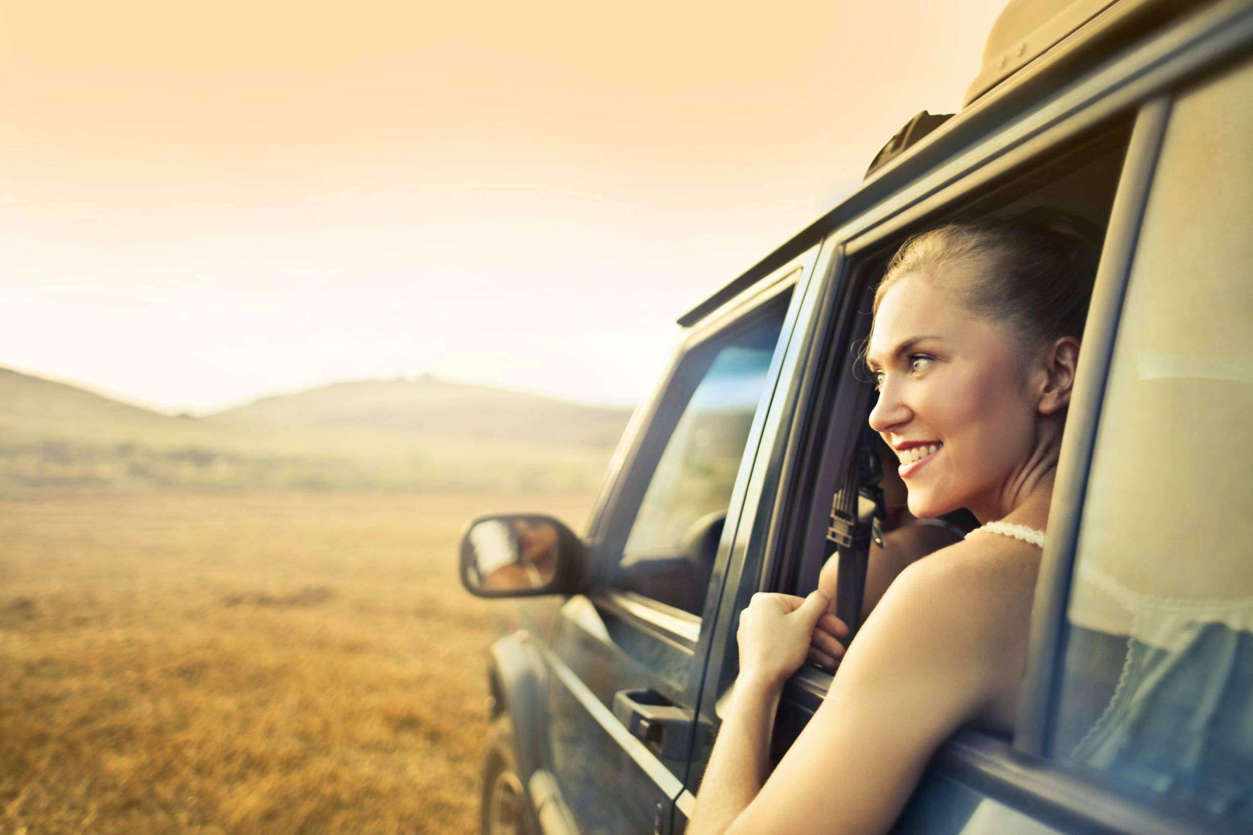 Woman staring out the window of a car