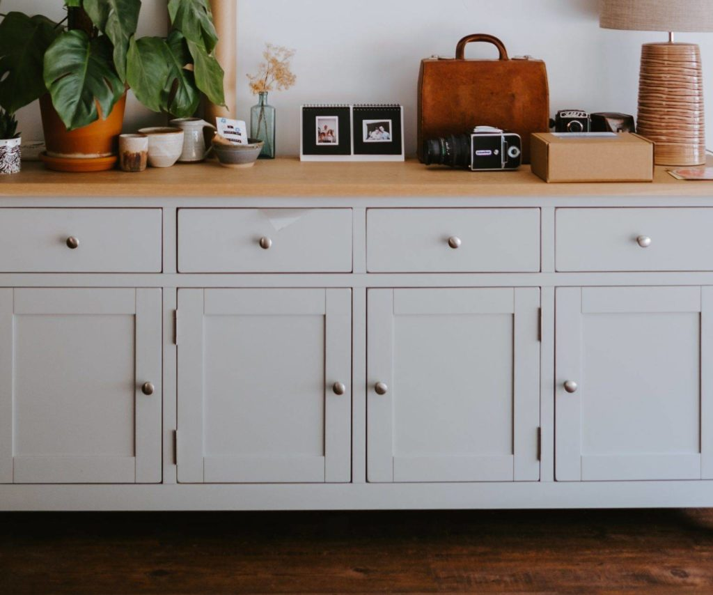 light blue cabinet with gold hardware