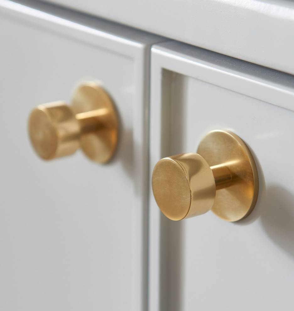 gold round knobs on white cabinets