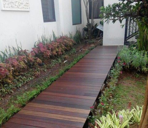 wooden boardwalk in backyard garden