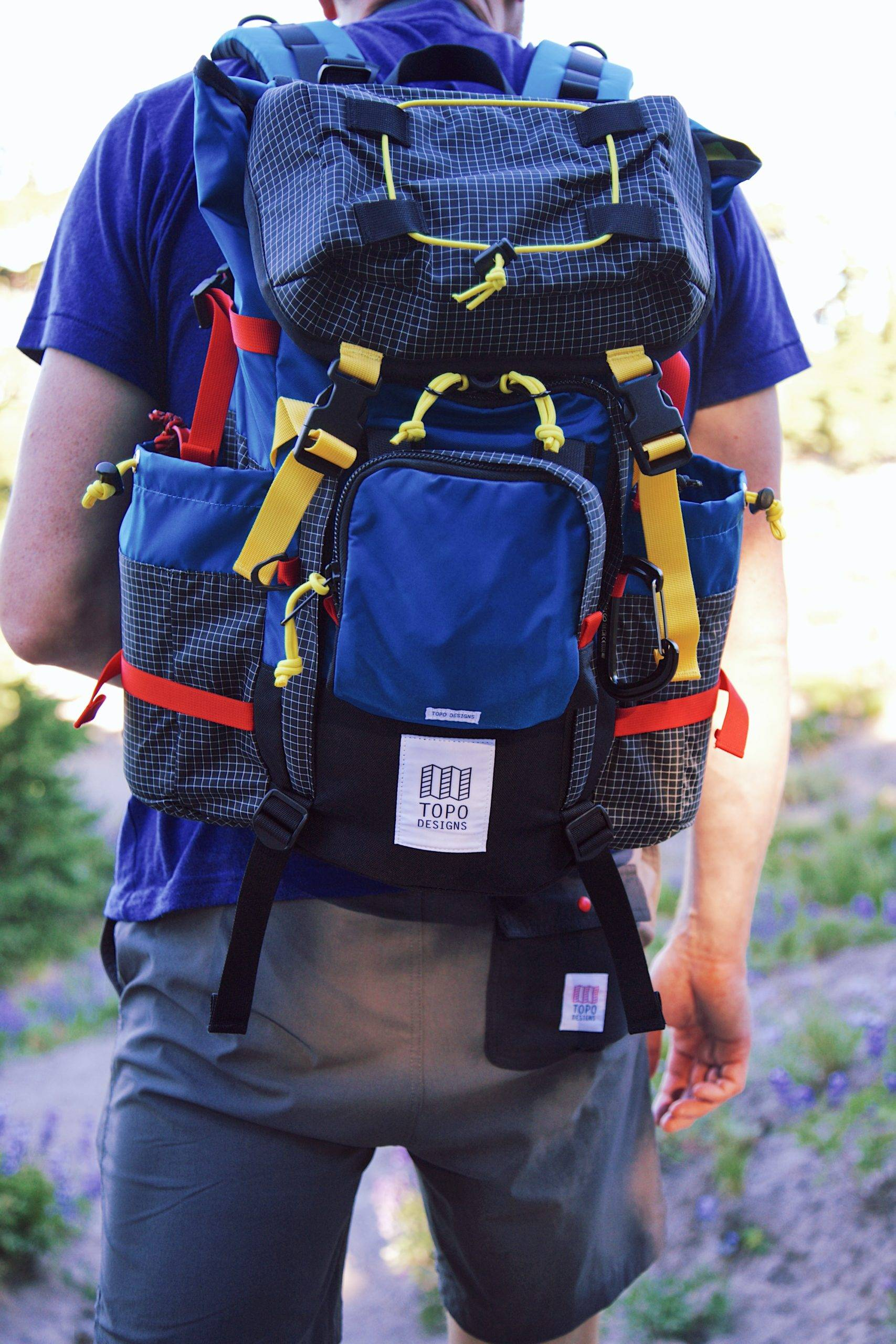 Blue backpack behind a man wearing blue shirt
