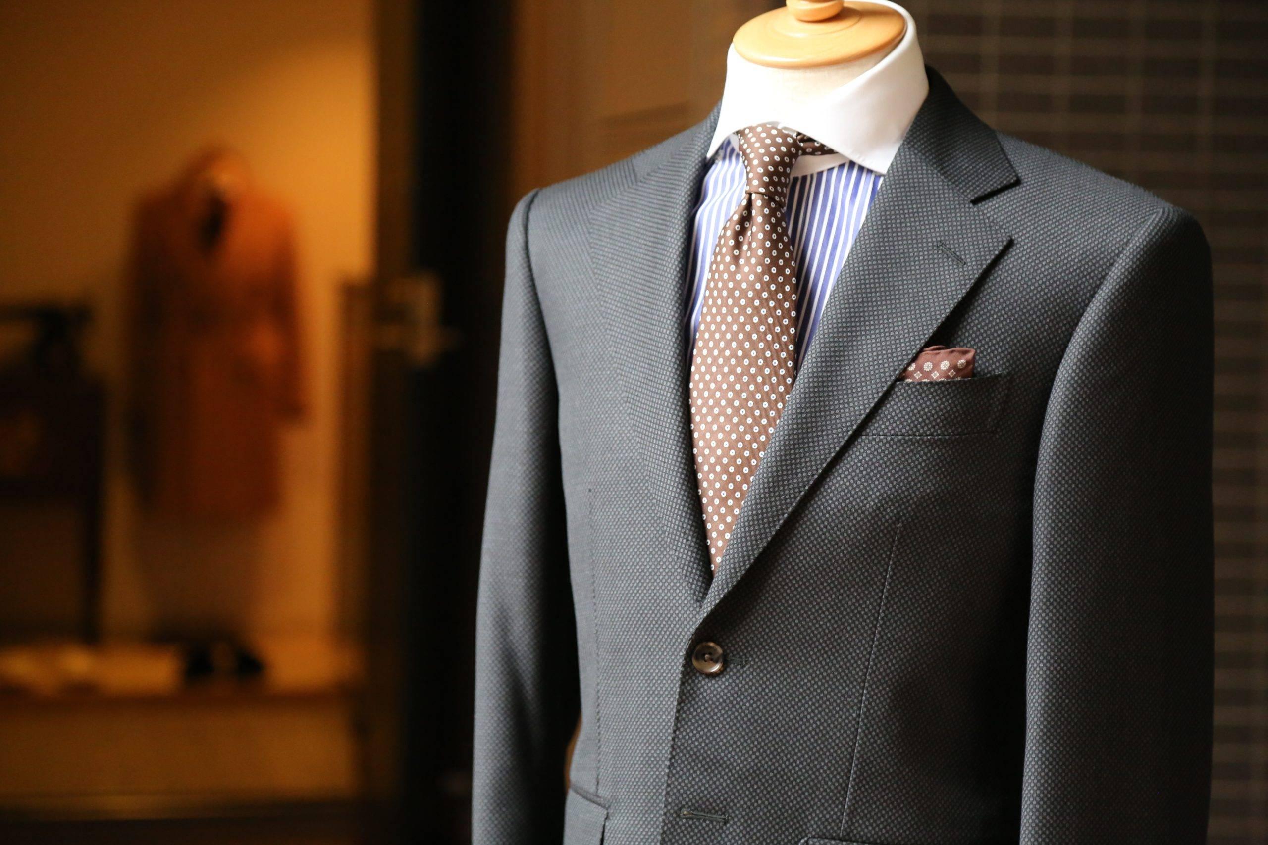 Grey suit with brown polka dots tie