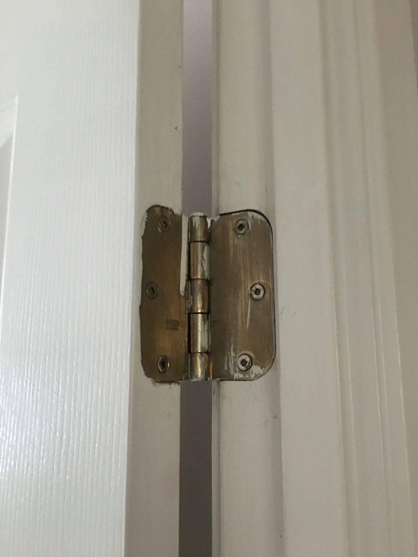 gold door hinge on white door