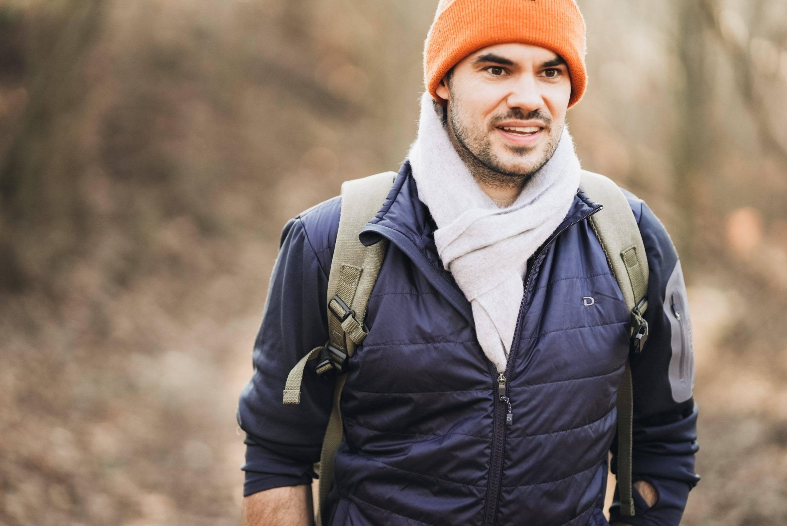 Man with orange toque hiking