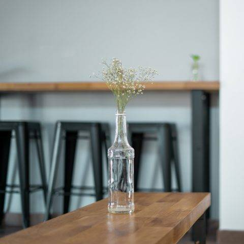 bar top with a vase and various furniture
