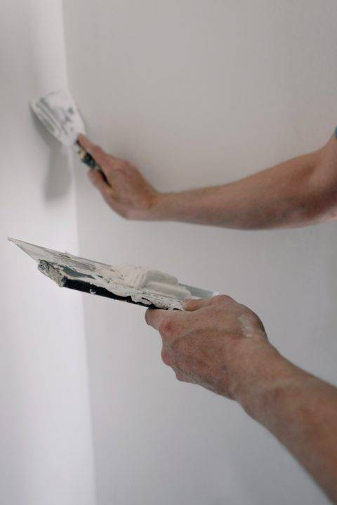 applying joint compound to a wall