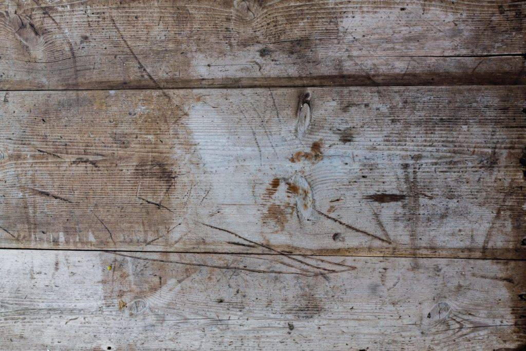 wood furniture with white stains and spots