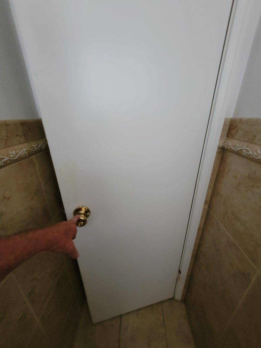 white door opening with gold knob