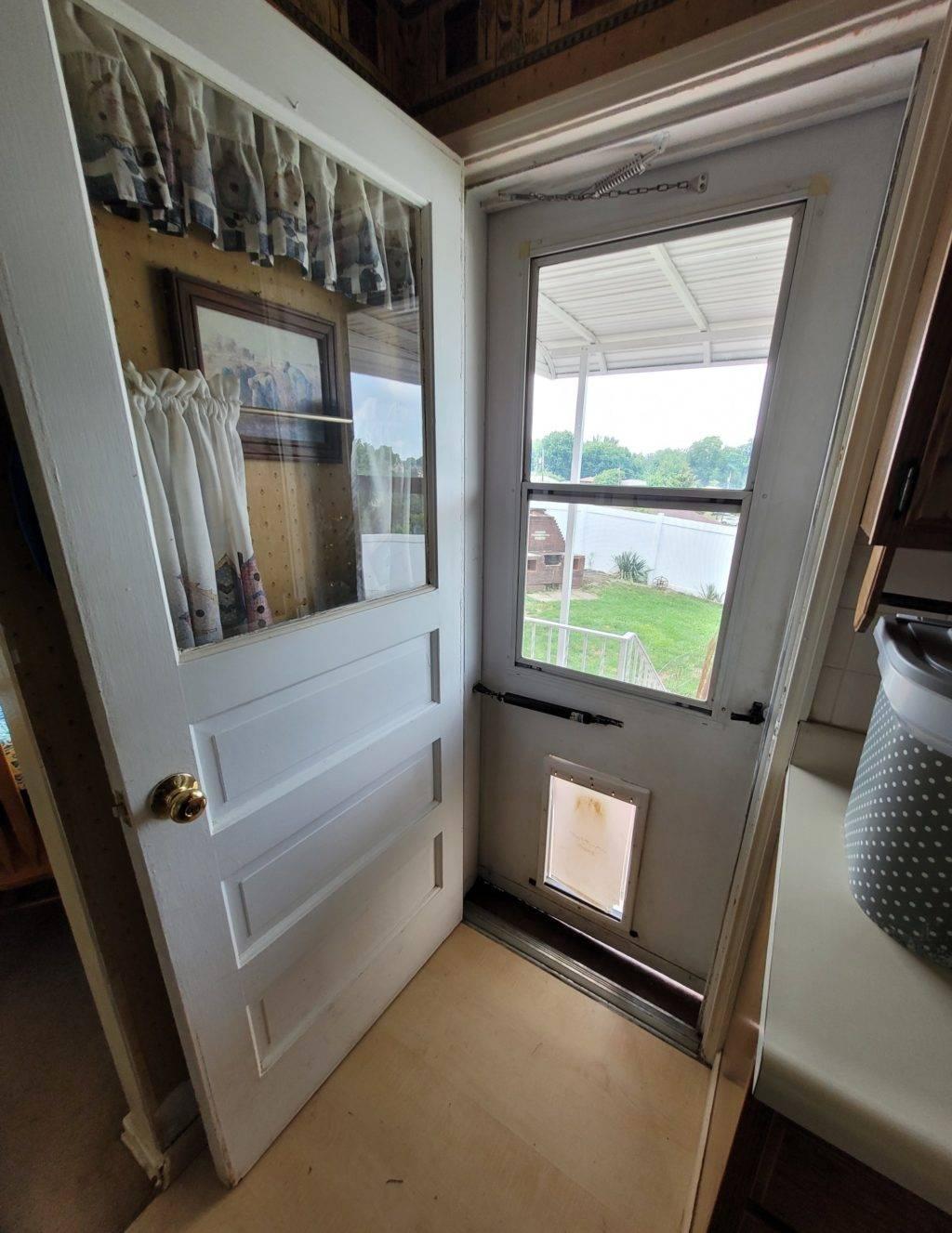 interior door opening to exterior storm door