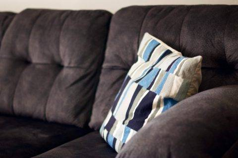 suede couch with pillow