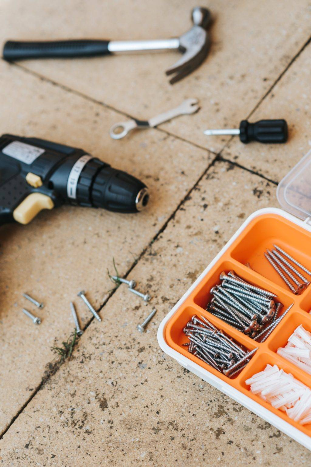 hammer, drill, assorted screws and drywall anchors