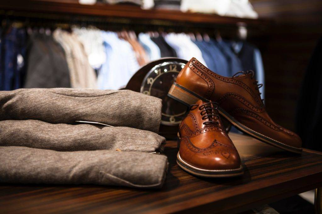 men's leather shoes next to clothing